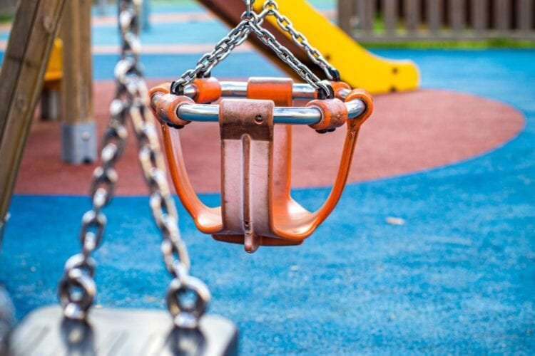 brown and black swing on blue and brown ground