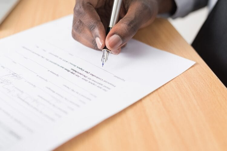person writing on white paper