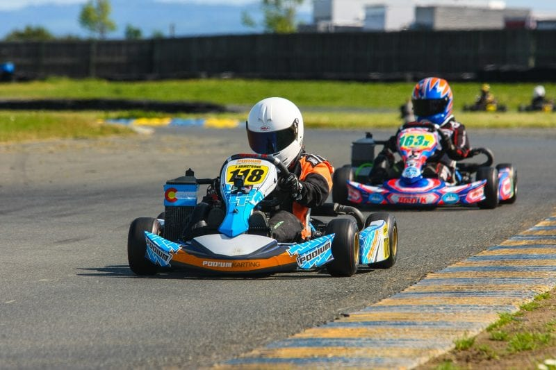 two go kart drivers on race track